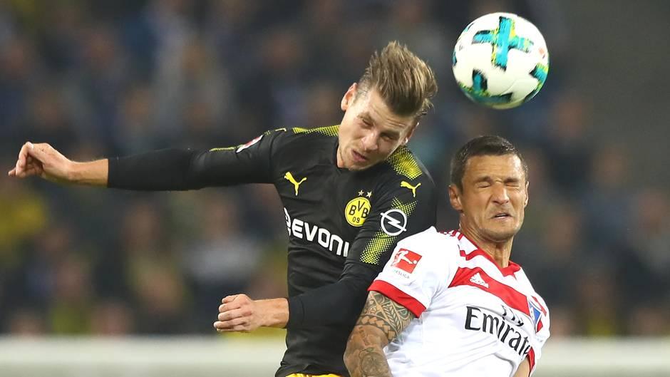 Augen zu und durch: Dortmunds Lukasz Piszczek (l.) und Sejad Salihovic vom Hamburger SV