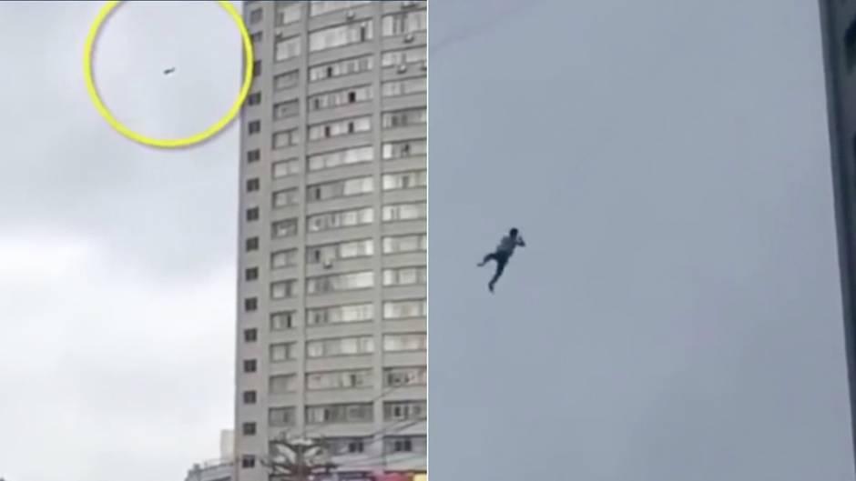 Drahtseilakt in China: Mann flieht an Telefonleitung aus Hotel - der Grund ist völlig absurd