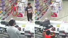 Kleiner Junge räumt die Kasse einer Apotheke leer