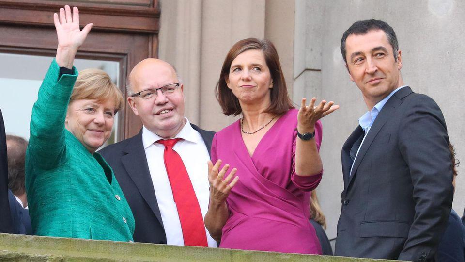 Merkel, Altmaier, Göring-Eckardt und Özdemir auf Balkon - sieht schon etwas nach Jamaika aus