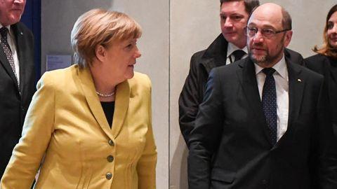 Angela Merkel und Martin Schulz - Werden CDU und SPD eine neue Regierung bilden?