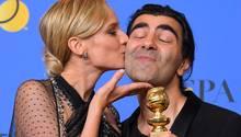 Regisseur Fatih Akin und Schauspielerin Diane Kruger feiern den Gewinn des Golden Globes