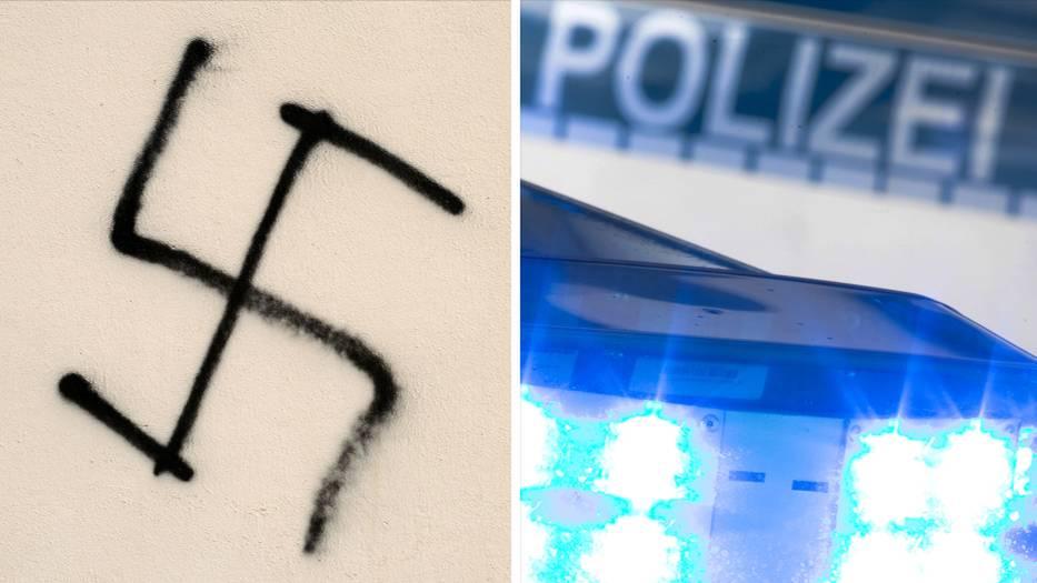 Vorfall in Chemnitz: ein an eine Hauswand geschmiertes Hakenkreuz und das Blaulich eines Polizeiwagens