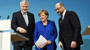 Horst Seehofer, Angela Merkel und Martin Schulz: Die Regierungsbildung nimmt Formen an, es lauern aber weiter Hürden