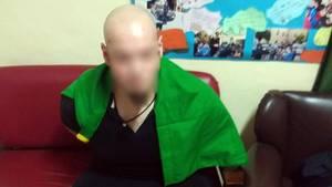 Luca Traini nach seiner Festnahme: Die italienische Flagge ruht auf seinen Schultern