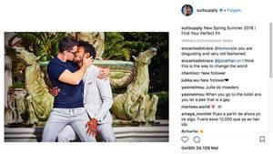 Ein Screenshot der Werbekampagne von Suitsupply. Darauf küssen sich zwei Männer.