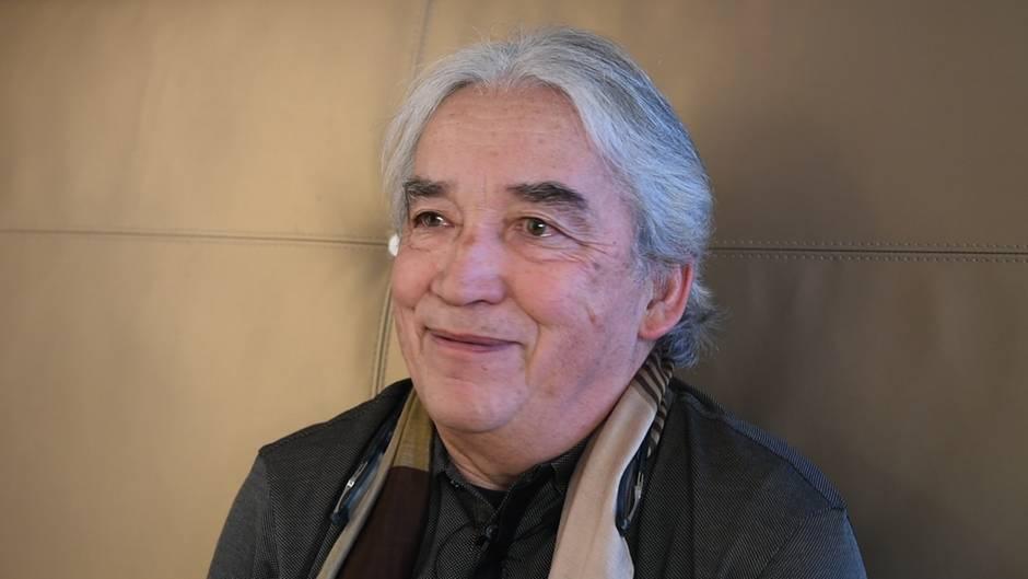 Gesicht von Dr. Ha Vinh Tho, dem Glücksminister von Buthan