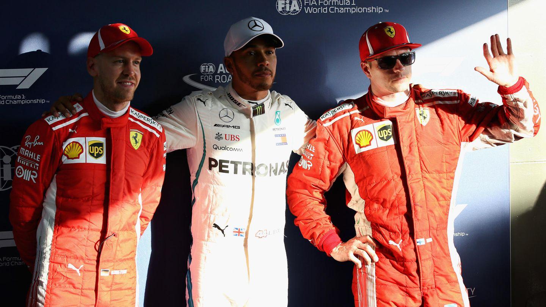 Formel-1-Fahrer Lewis Hamilton (M.), Kimi Raikkonen (r.)  und Sebastian Vettel
