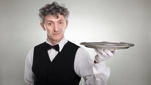 Französischer Kellner wird wegen Rüpelhaftigkeit entlassen und schiebt es auf seine Kultur (Symbolbild)