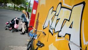 """""""Kita""""-Graffiti an einer Wand"""