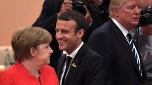 Angela Merkel, Emmanuel Macron und Donald Trump
