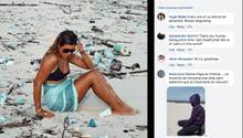 Eine Frau sitzt umgeben von Plastikmüll im Strandsand
