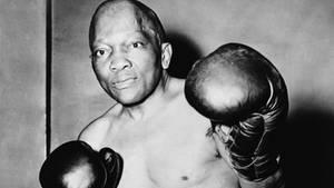 Jack Johnson, hier auf einem Bild von etwa 1930, war der erste afroamerikanische Schwergewichtsweltmeister im Boxen