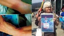 Irmela Mensah-Schramm hält ein Anti-AfD-Plakat hoch
