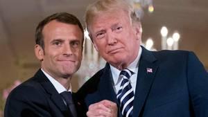 der französische Präsident Emmanuel Macron (l.) und US-Präsident Donald Trump