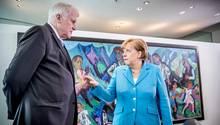 Auf Konfrontationskurs: Bundesinnenminister Horst Seehofer (CSU, l.) und Bundeskanzlerin Angela Merkel (CDU)