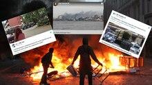 G20-Randalierer stehen in der Hamburger Sternschanze vor einer brennenden Barrikade