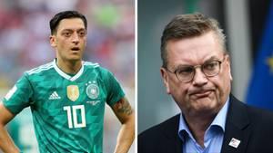 DFB-Präsident Reinhard Grindel (r.) erwartet, dass Mesut Özil (l.) sich nach dem Urlaub öffentlich äußert