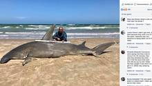 Angler Poco Cedillo kniet neben seinem Hai-Fang