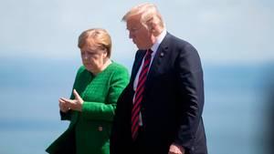 Donald Trump und Angela Merkel während des G7-Treffens in Kanada