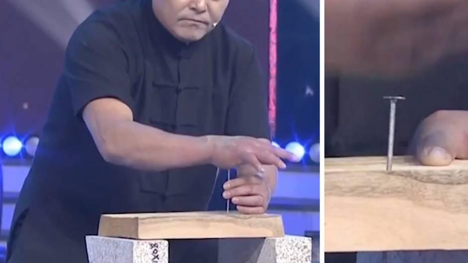 Unglaubliche Kraft: Mann schlägt Nägel mit bloßen Händen ein