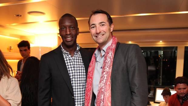 Olympia-Goldmedaillengewinner Michael Johnson zusammen mitNicholas Frankl 2013