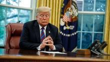 US-Präsident Donald Trumpan seinem Schreibtisch im Oval Office des Weißen Hauses