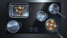 Auf dem neuen Siemens-Kochfeld lassen sich bis zu sechs Kochutensilien frei platzieren und bewegen.