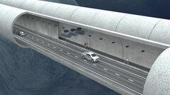 Wer mag, kann den kilometerlangen Tunnel auch zu Fuß durchqueren.