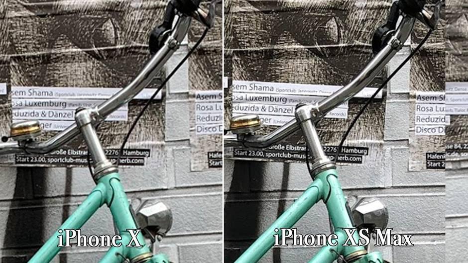 Der Bildausschnitt wurde um 300 Prozent vergrößert, die Schrift im Hintergrund ist beim XS besser lesbar.