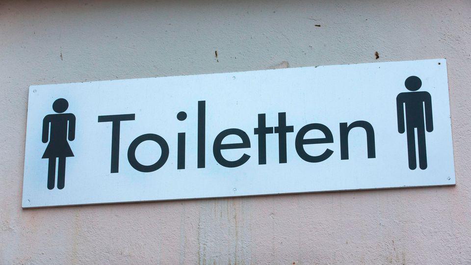 Putzmann: Schild einer öffentlichen Toilette