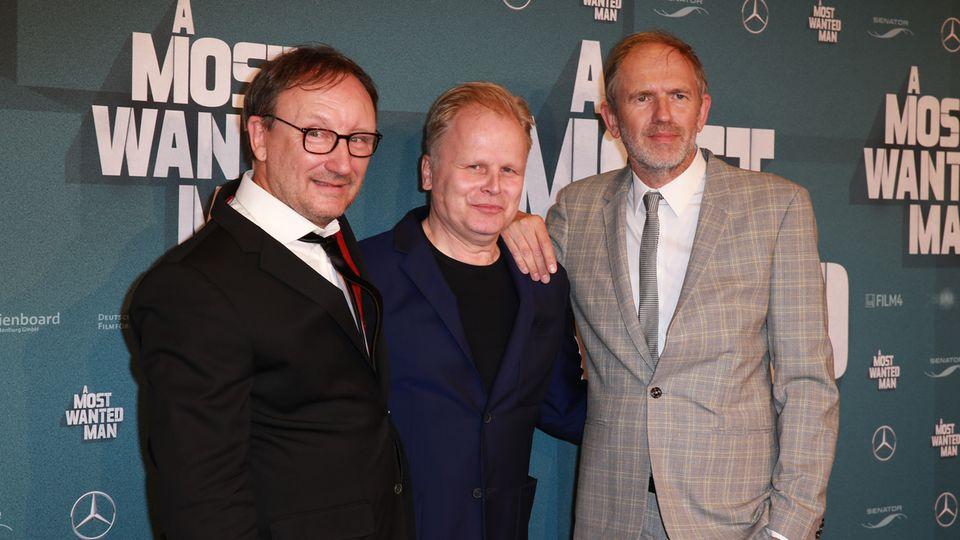 """Rainer Bock mit Herbert Grönemeyer und Regisseur Anton Corbijn bei der Premiere von """"A Most Wanted Man"""""""