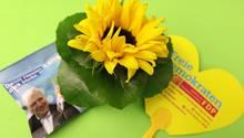 Eine Bonbontüte der CDU, eine Sonnenblume der Grünen und ein Herz der FDP