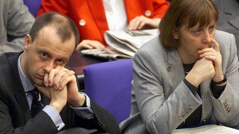 Friedrich Merz und Angela Merkel im Bundestag