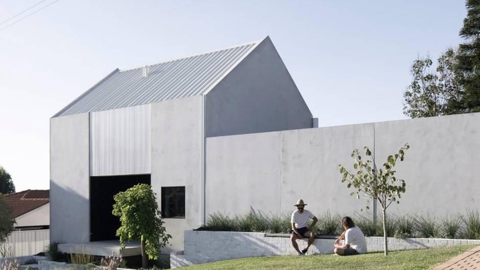 Haus 1 setzt auf klare, reduzierte Formen und einen hellen Betonlook.