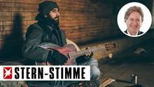 Straßenmusiker mit Gitarre (Symbolbild)