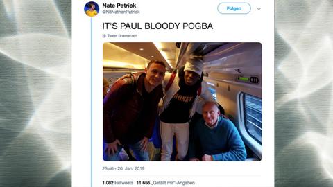 Paul Pogba und Nemanja Matic mit dem Vater von Nate im Zug