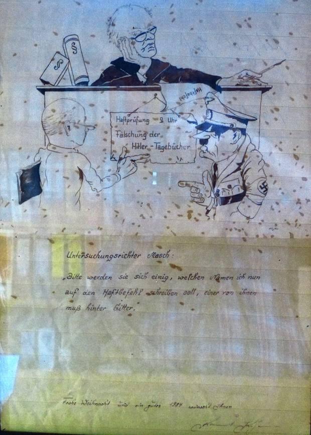 """Die Karikatur, die Kujau Untersuchungsrichter Masch zu Weihnachten geschenkt hat. Unter dem Bild steht:  Untersuchungsrichter Masch: """"Bitte werden sie sich einig, welchen Namen ich nun auf den Haftbefehl schreiben soll, einer von ihnen muss hinter Gitter.""""  Ganz unten steht: Frohe Weihnacht und ein gutes 1984 wünscht Ihnen Konrad Kujau"""