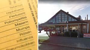 Masern-Schriftzug im Impfpass, McDonald's-Restaurant in München