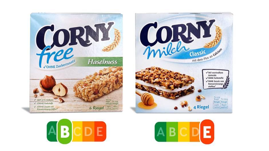 """Corny Free hatkaum Zucker und gesättigte Fette, dafür viele Proteine und Ballaststoffeund verdient sich so ein grünes """"B"""". Corny Milch dagegen enthält laut Foodwatch mehr Zucker und Fett als eine Schoko-Sahne-Torte. Der Nutri-Score würde dies auf den ersten Blick sichtbar machen."""