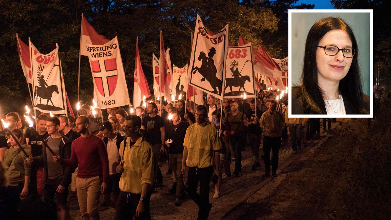 Ein Aufmarsch der Identitären in Wien mit einem Bild von Natascha Strobl.