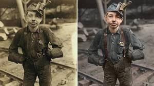 Ein kleiner Junge mit Kohlenstaub im Gesicht