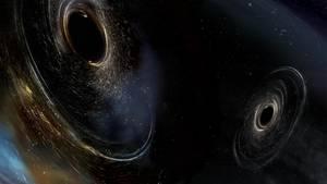 Diese Grafik zeigt zwei verschmelzende Schwarze Löcher.