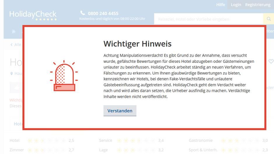 Warnung auf der Website von holidaycheck.de: Hinter dieser Besprechung könnte ein Netzwerkvon Bewertungsfälschern stecken