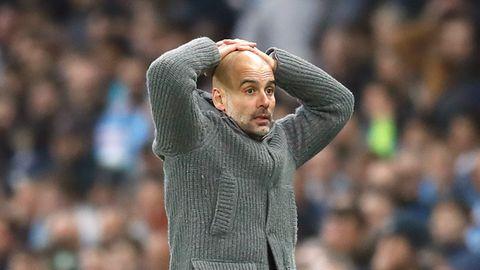 Pep Guardiola blickt fassungslos, nachdem er wieder mit Manchester City in der Champions League gescheitert ist