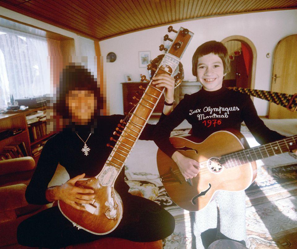 Dieses Bild verrät es: Wir haben es hier mit einer musikalischen Familie zu tun. Wissen Sie, mit welcher?