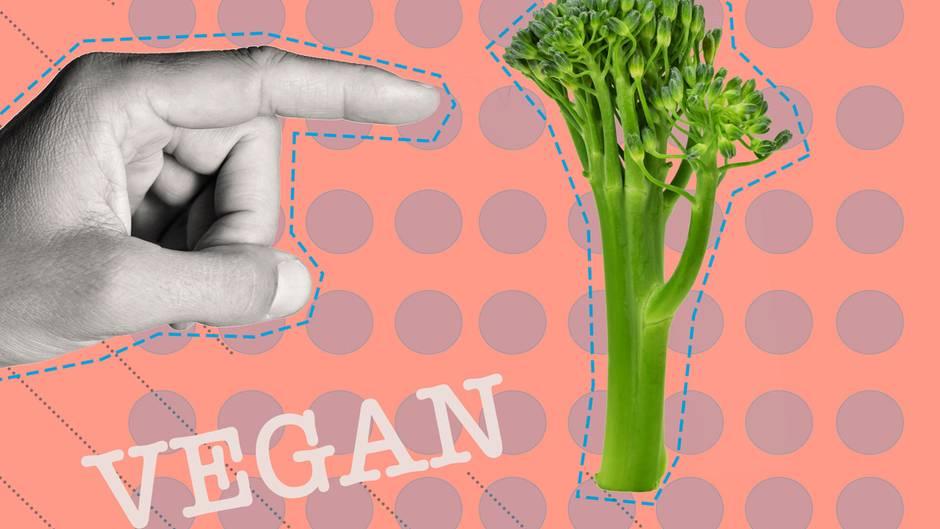 Ein Finger der auf einen Brokkoli zeigt