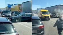 Auf der Autobahn A1, Höhe Lübeck-Möslingen, wenden Autofahrer nach einem schweren LKW-Unfall mitten in der Rettungsgasse.