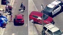 """Ein dreister Autodieb in Los Angeles fühlte sich auf seiner Flucht vor der Polizei so sicher, dass er """"High fives"""" an Passanten verteilte."""