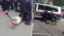 Polizisten fixieren einen Demonstranten am Boden